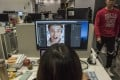 At Megvii offices in Beijing, a designer prepares marketing material for a facial-recognition product. Photo: The Washington Post/Gilles Sabrie