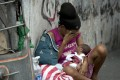 A homeless woman and her baby in Manila, in the Philippines, where abortion is illegal. Routinely vilified in the Western media, President Rodrigo Duterte opposes the powerful Catholic Church on, among other issues, contraception. Picture: AFP