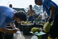 Malaysians are dashing to durian stalls across the country to munch on the pungent, spiky fruit after a long spell of unusually warm weather led to a bumper crop and sent prices tumbling. Photo: AFP