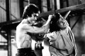Bruce Lee and Jackie Chan in a scene from Enter The Dragon. After Lee's death, film director Lo Wei tried to groom Chan as Lee's replacement, but the actor went his own way. Photo: Alamy