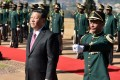Chinese President Xi Jinping (left) inspects a military honour guard at the Union Building in Pretoria on Tuesday, during his state visit to South Africa. Photo: AFP