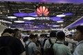 Attendees stand at the Huawei Technologies booth at the Mobile World Congress event in Shanghai, which was held in June this year. Based in Shenzhen, Huawei is the world's largest telecommunications equipment supplier and China's biggest smartphone brand. Photo: Bloomberg