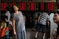 Investors monitor stock market movements at a brokerage house in Shanghai. Photo: AFP