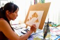 Agnes Gerrits-Lim says that her emotional wellbeing has improved since taking up painting five years ago.