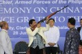 Philippine President Rodrigo Duterte checks a Chinese-made rifle during the ceremonial handover of military weapons from China to the Philippines inm 2017. File photo: EPA