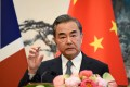 Foreign Minister Wang Yi said China and the US should resolve trade frictions through the WTO framework. Photo: AFP