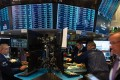 Futu allows Chinese investors to trade in US stock markets while the domestic exchanges are in the doldrums. Photo: AFP