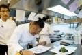 Singaporean celebrity chef Justin Quek prepares a dish at Singapore's Marina Bay Sands resort. Photo: AFP