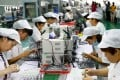 Staff work on a micro motor production line at a factory in Huaibei, Anhui province. Beijing wants banks to improve their internal systems to encourage lending to small business. Photo: AFP