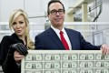 "US Treasury Secretary Steven Mnuchin, an investment banker before joining the Trump administration, roused public criticism when he and his wife, Louise Linton posed with a sheet of uncut dollar notes in November 2017, with observers comparing them to ""Bond villains"". Photo: Bloomberg"