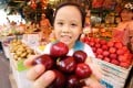 Chloe Lam holds a bunch of cherries she bought at the Yau Ma Tei Fruit Market. Photo: Dickson Lee