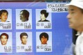 A street television screen in Tokyo in July shows six former Aum Shinrikyo cult members who were executed earlier in the day. Photo: Kyodo