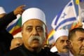 """Israeli Druze spiritual leader Sheikh Muwafaq Tarif at a rally in Tel Aviv on Saturday where members of his community and their supporters protested against the """"Jewish Nation-State Law"""". Photo: AFP"""