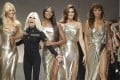 Italian designer Donatella Versace (second left) with models (from left) Claudia Schiffer, Naomi Campbell, Cindy Crawford and Helena Christensen on the catwalk at the end of the Versace women's Spring/Summer 2018 fashion collection, in Milan, Italy, in September 2017. Versace in March 2018 became the latest fashion house to eliminate fur from its collections, joining Gucci, Giorgio Armani and Hugo Boss, among others. Photo: AP