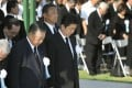Japanese Prime Minister Shinzo Abe along with other officials offer a silent prayer during a ceremony marking the 73rd anniversary of the US atomic bombing of Hiroshima. Photo: Kyodo