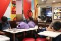 Residents sleeping at the McDonald's in Cheung Sha Wan. Photo: Roy Issa