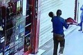 A man was seen carrying the boy away outside a supermarket. Photo: m.people.cn