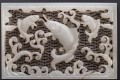 A jade belt plaque carved with fish – which symbolise wealth and fortune – which is featured in Michael Liu's book, 'In Pursuit of Fine Jades: Ming Court Belt Plaques'.