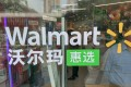 A sign of Walmart is seen at its first supermarket in China. The global retail giant said it invested about US$320 million in the latest fundraising of Logistics services company Dada-JD Daojia. Photo: Reuters