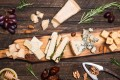 Many cheese lovers opt for a cheese platter instead of dessert. Different types of cheese should be accompanied by different kinds of wine, and grapes, nuts, honey, bread and dates are perfect complements to cheeses. Photo: Thinkstock
