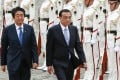 "Japanese Prime Minister Shinzo Abe (left) highlighted Chinese Premier Li Keqiang's visit to Japan in May, saying he was ""very pleased to have Japan-China relations return to a normal path"". Photo: EPA-EFE"