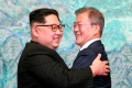 North Korean leader Kim Jong-un and South Korean President Moon Jae-in embrace each other after signing a joint statement at the border village of Panmunjom in April. File photo: AP