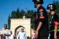 Police patrol outside the Id Kah Mosque after morning prayers, in Kashgar in Xinjiang. Photo: AFP