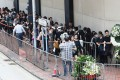 Nearly a thousand fans queue up outside Hong Kong Funeral Home. Photo: Nora Tam