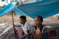 Vee Keoheuy and her husband at the Sanamxai rescue base. Pictures: Thomas Cristofoletti