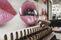 A shop assistant arranges lipsticks at a mall in Shanghai. Photo: Bloomberg