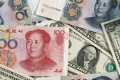 It is vital for Beijing to ensure the value of its US dollars – its main diplomatic tool for buying influence with low-interest loans and aid. Photo: Kyodo