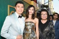 Henry Golding (left), Gemma Chan, and author Kevin Kwan on the red carpet of the Crazy Rich Asians premier. Photo: AFP