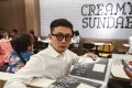 Mainland artist Ma Yujiang, 30, moved to Hong Kong and ended up sleeping at McDonald's outlets to get away from his tiny flat and be near others. Photo: Nora Tam