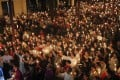 Vietnamese Catholics pray for the release of a lawyer accused of spreading anti-state propaganda. Photo: Reuters