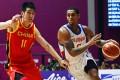 Jordan Clarkson takes on Liu Zhixuan on Tuesday. Photo: EPA