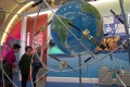 """Visitors look at a display of satellite technologies at an exhibition in Beijing in October that highlighted China's achievements. US officials have voiced frustration with Beijing's technological ambitions and its """"Made in China 2025"""" strategy. Photo: AP"""