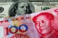 The yuan is expected to come under further pressure. Photo: Reuters
