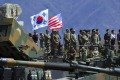 South Korean and US soldiers watch a live firing drill during joint exercises in April 2017 in Pocheon, South Korea. Photo: AFP