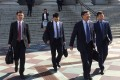 Members of a Chinese Trade delegation leave the US Treasury building after two days of talks with US representatives in Washington on Thursday. Photo: AFP