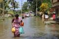 People wade through floodwater in Kerala. Photo: Xinhua