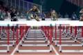 Hong Kong's Vera Lui Lai-yiu races in her semi-final heat of the women's 100-metre hurdles at the Asian Games in Indonesia. Photo: EPA