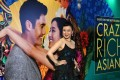 Chinese jazz singer Jasmine Chen, who performed in the film, poses at the premiere of the film Crazy Rich Asians at Capitol Theatre in Singapore on August 21. Will the film's portrayal of Asia's ultra rich leave the audience with the wrong impression that all Asians are rich and live fanciful lives? Photo: AFP