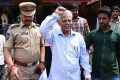 Indian poet and activist Varara Rao is escorted after his arrest in Hyderabad on Tuesday. Photo: AFP