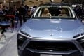 Car enthusiasts check out the NIO ES8 during a media preview of the Auto China 2018 motor show in Beijing on April 25, 2018. Photo: Reuters