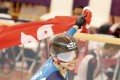 Hong Kong cyclist Sarah Lee celebrates with the flag after winning the women's sprint in Jakarta. Photo: HKSF&OC