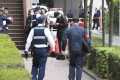 File photo of police investigating the scene of a possible robbery in Fukuoka, Japan. Photo: Kyodo
