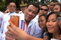 Philippines' President Rodrigo Duterte poses for a selfie with students this week in Manila. Photo: AFP