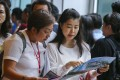 Potential buyers queue up for SHKP's residential project St Martin at the International Commerce Centre in West Kowloon on July 14, 2018. Photo: SCMP
