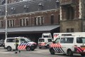 Dutch police near the scene of a stabbing attack at Amsterdam's Central Station on Friday. Photo: AP