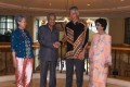 Malaysia's Prime Minister Mahathir Mohamad shaking hands with Singapore Prime Minister Lee Hsien Loong, as Mahathir's wife Siti Hasmah Mohamad Ali and Lee's wife Ho Ching look on. Photo: AFP
